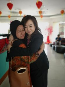 Eliza and Marlina embrace at the Zara Boutique Hotel. Eliza donated an oven and a sewing machine to Marlina with the hope that they would help her rebuild her life.